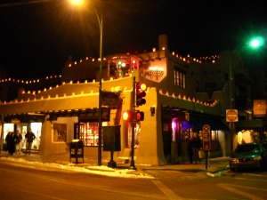Farolitos Line the Roof of La Fonda copyright G G Collins